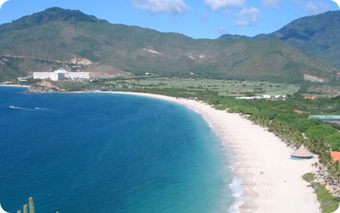 playa arena arrecife coral