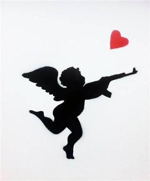 tatuajes-de-cupido-para-san-valentin-gracioso-metralleta