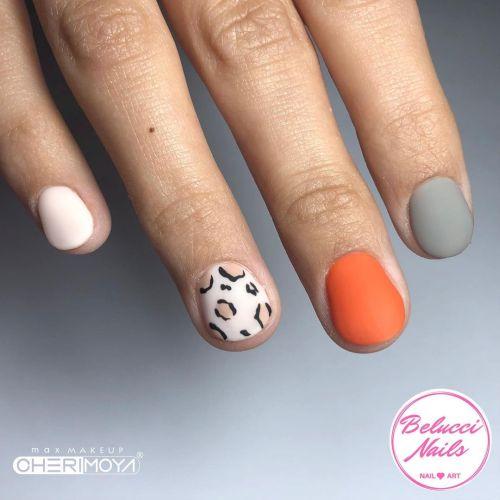 Uñas skittles naranja, gris y estampado animal