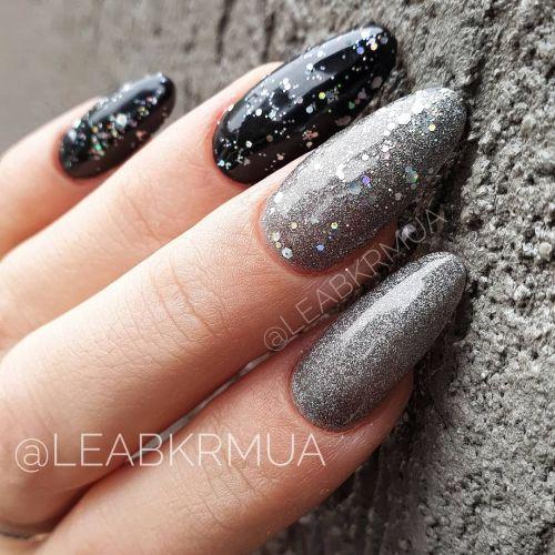 Uñas negras almendradas con brillo