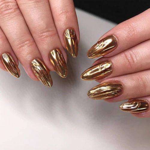 Uñas almendras color bronce