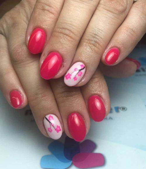 Uñas coral con blanco y adornos en rosa