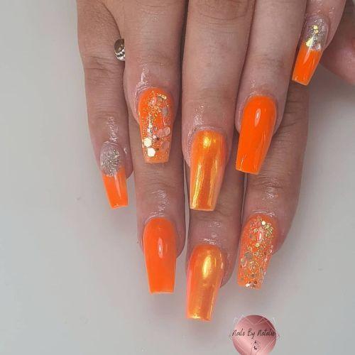 Uñas espejo naranjas