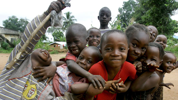 -PHOTO TAKEN 21JUL05- Sierra Leonian kids pose in Kailahun, about 19kms (12 miles) away from the Lib..