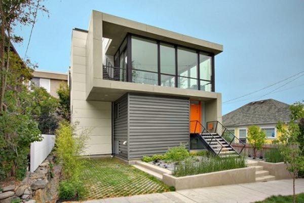 fachadas-de-las-casas-más-bonitas-y-modernas-dos-pisos-puerta-naranja