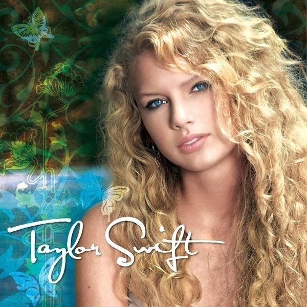 cortes-de-pelo-y-peinados-taylor-swift-pelo-largo-con-rizos