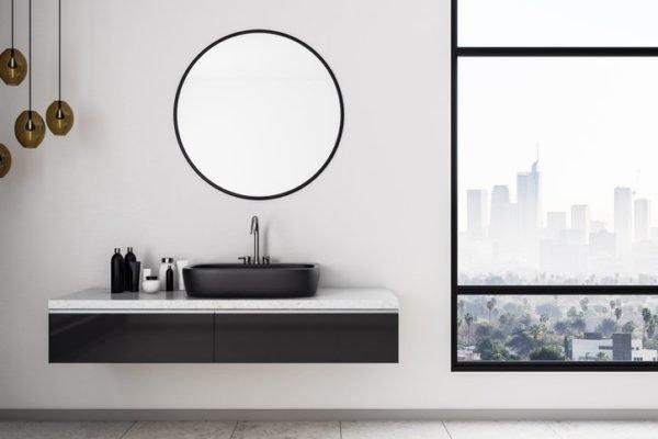 Como decorar una pared con espejos bano redondo
