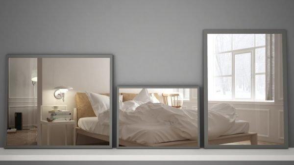 Como decorar una pared con espejos dormitorio trio