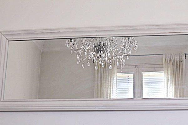 Como decorar una pared con espejos salon