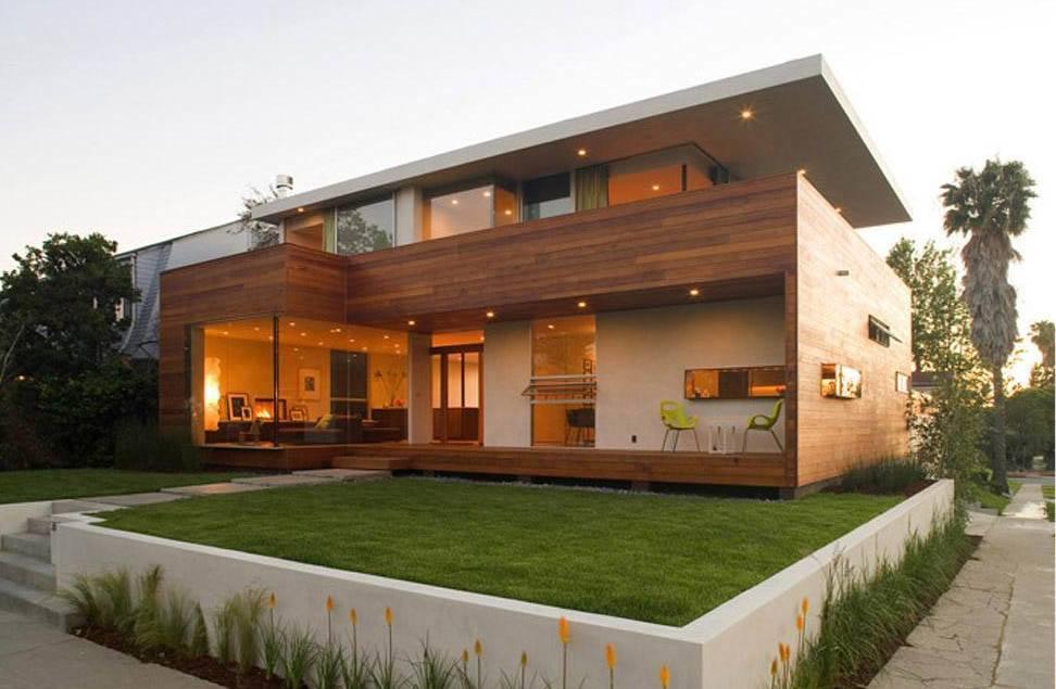 Casa moderna de madera con cubierta plana for Casas de madera modernas