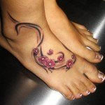 cherry-blossom-tribal-foot-tattoo